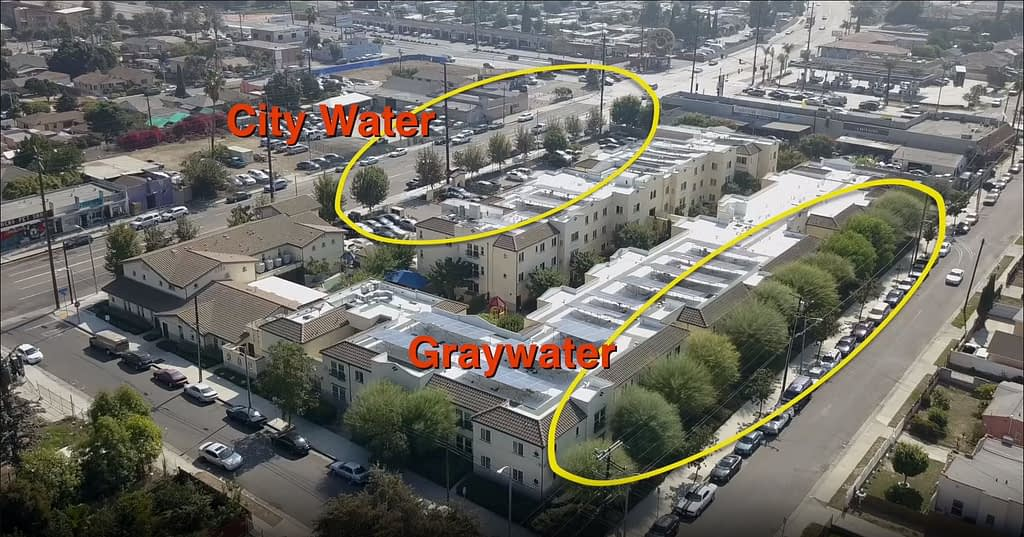 Drone footage of Casa Dominguez  apartment complex in Los Angeles showing the results of city water (small trees) and greywater (large trees)